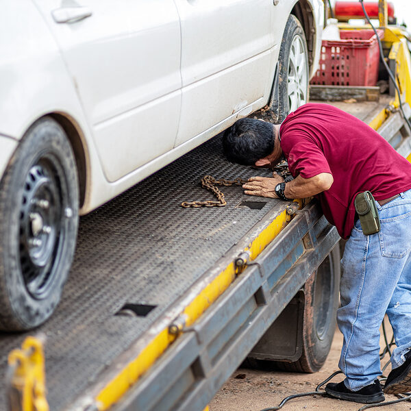 worker checking the car tire