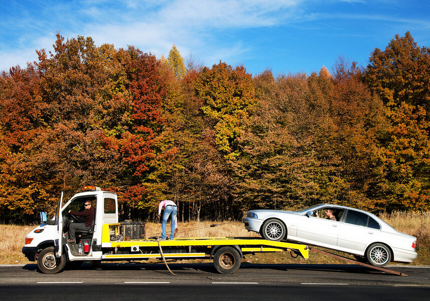 white car being towed